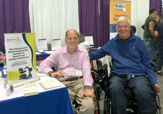Two smiling men in wheelchairs at the MassMATCH Abilities Expo booth.