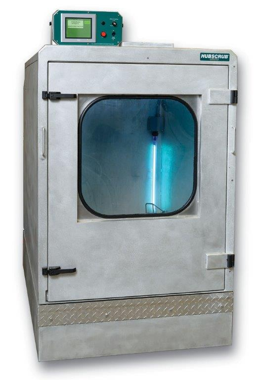 A metal box with front door with a glass window that swings outwards. A small electronic control box is mounted on top.