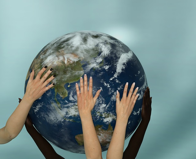 Hands on a globe of the earth