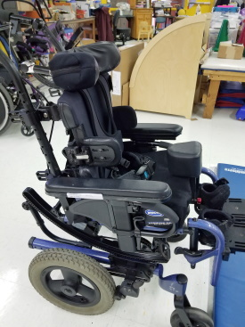 Side view of pediatric manual tilt wheelchair