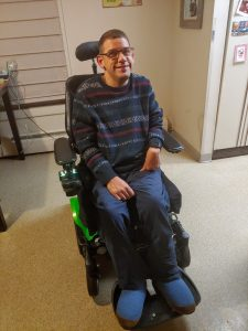 Kevin using his back up power wheelchair.